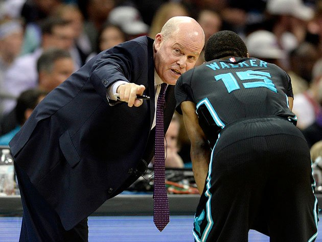 Steve Clifford points to the logo in the middle of the court. (Getty Images)