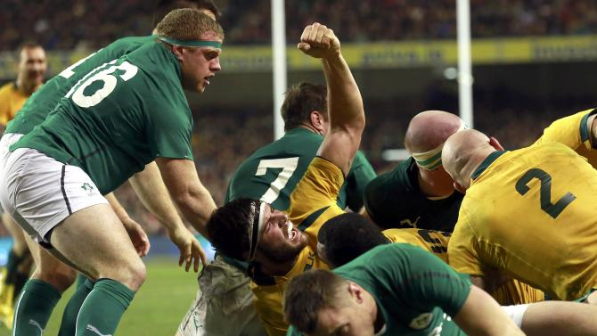 Australia's Simmons celebrates a try in in their International rugby union match against Ireland in Dublin
