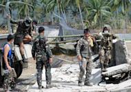 This file photo shows soldiers unloading a body bag containing a victim of a flash flood caused by Typhoon Bopha near the municipal hall in New Bataan, Compostela Valley province, on December 8, 2012. The death toll from the typhoon that devastated the Philippines earlier this month will likely hit 1,500, making it the second deadliest since the country began keeping records