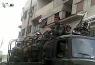 An image grab taken from a video uploaded on YouTube shows Syrian forces deploying in Saqba on the outskirts of Damascus. AFP cannot independently verify this image. Syria on Sunday demanded guarantees that armed groups cease fire before withdrawing its troops from protest hubs as agreed with special envoy Kofi Annan, even as a UN truce deadline loomed