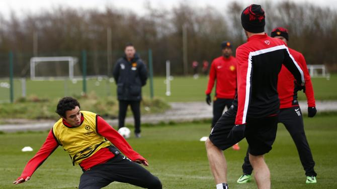 Manchester United's Rafael challenges Carrick during a training session in Manchester