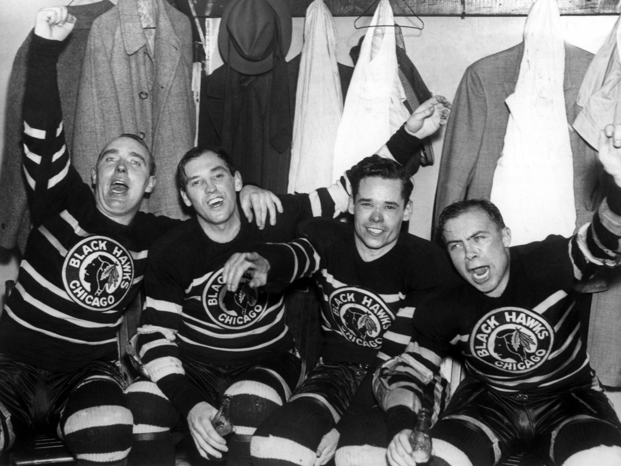 L-R) Jack Shill, Carl Voss, Cully Dahlstrom and Harold 'Mush' March of the Chicago Blackhawks celebrate in the locker room after they defeated the Toronto Maple Leafs in Game 4 of the 1938 Stanley Cup Finals on April 12, 1938 at Chicago Stadium in Chicago, Illinois. The Blackhawks defeated the Maple Leafs 4-1. (Photo by B Bennett/Getty Images)