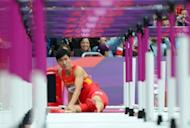 China's Liu Xiang fall during the men's 110m hurdles heat at the London Olympics on August 7. China's track hopes went up in smoke when Liu heart-breakingly limped out of the heats for the second Games running with a career-threatening Achilles tendon tear