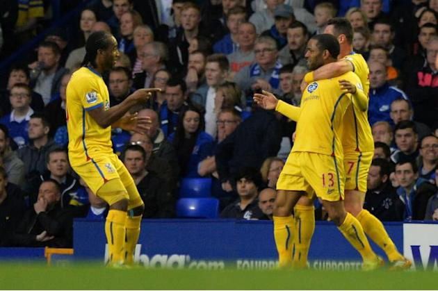 Crystal Palace's English midfielder Jason Puncheon (2-R) celebrates scoring a goal at Goodison Park in Liverpool on April 16, 2014