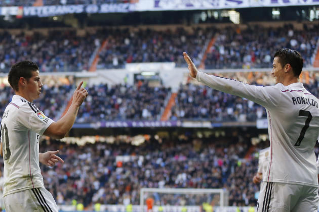 Real Madrid's James Rodriguez, left, celebrates his goal with teammate Cristiano Ronaldo, right, during a Spanish La Liga soccer match between Real Madrid and Espanyol at the Santiago Bernabeu stadium