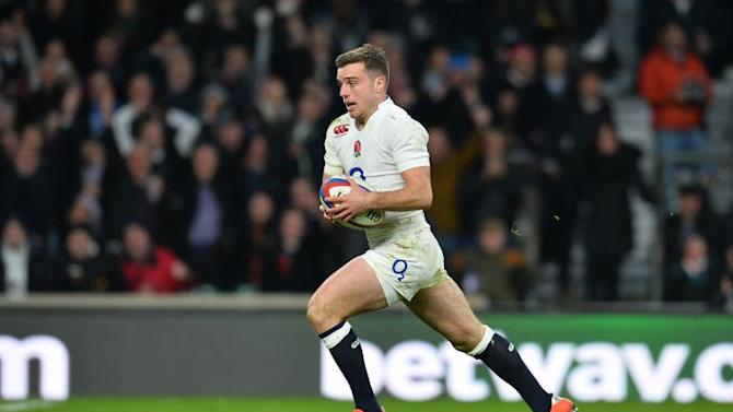England's fly half George Ford runs in to score England's fourth try during the Six Nations international rugby union match between England and France at Twickenham Stadium, south west of London, on March 21, 2015