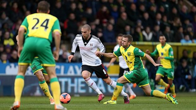 Fulham's Pajtim Kasami skips past a challenge from Norwich City's David Fox (PA Sport)