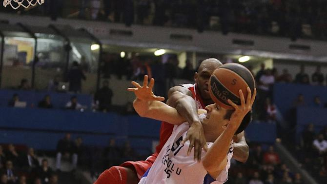Olympiakos' Cedric Collins, left, fouls Anadolou Efes' Milko Bjelica during their Euroleague basketball match of Top 16 in the port of Piraeus, near Athens, Thursday, Feb. 13, 2014