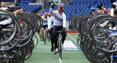 "Former England rugby union player Lawrence Dallaglio raises a glass of champagne as he cycles into Murrayfield stadium to complete his ""Dallagio Cycle Slam"", Edinburgh"