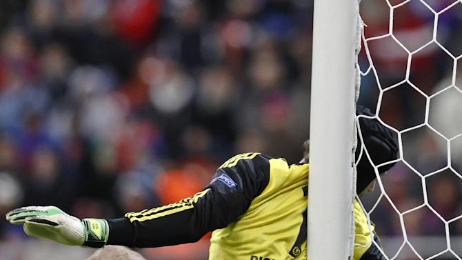 Chelsea goalkeeper Petr Cech hits his back against a goal post during the soccer Champions League group E match between Steaua Bucharest and Chelsea in Bucharest, Romania, Tuesday, Oct. 1, 2013