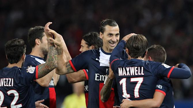 Paris Saint Germain's forward Zlatan Ibrahimovic from Sweden, center, celebrates with teammates, after he scores a goal, during his French League One soccer match against Monaco, at the Parc des Princes stadium, in Paris, Sunday, Sept. 22, 2013