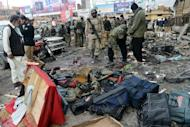 Pakistani security personnel examine the site of a bomb explosion in Quetta on January 10, 2013. Quetta has been a flashpoint for attacks against Shiites, in particular those from the ethnic Hazara minority, as well as suffering from attacks linked to a separatist insurgency and Islamist militancy