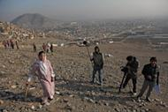 "Members of the crew from the movie ""Kabul I Love You"" film in Kabul. A decade after the fall of the cinema-hating Taliban, a group of Afghan directors have created a film love letter to their capital, rooted in the grim reality of everyday life in the war-torn city"