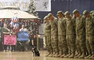 US soldiers stand in formation along with a therapy dog as they wait to be released at a welcome home ceremony in Fort Carson, Colorado, on November 4, 2012. After years of being a little-talked about subject, PTSD is increasingly acknowledged as a mental health epidemic in the United States