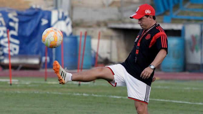 Gallardo, coach of Argentina's River Plate, kicks a ball during a training session at Tecnologico stadium in Monterrey