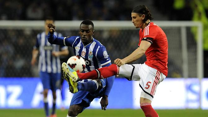 FC Porto's Jackson Martinez from Colombia, challenges Benfica's Ljubomir Fejsa, right, from Serbia in a Portugal Cup semifinal first leg soccer match at the Dragao stadium in Porto, Portugal, Wednesday, March 26, 2014. Jackson scored the only goal in Porto's 1-0 victory