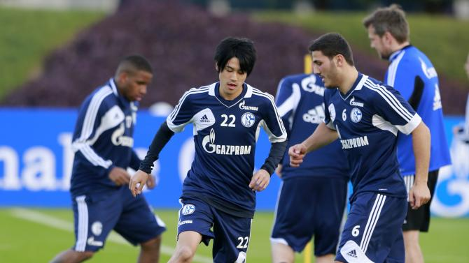 Schalke 04's Atsuto Uchida controls the ball during a training session at the Aspire Academy of Sports Excellence in Doha