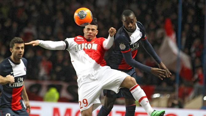 Monaco's Emmanuel Riviere of France, left, challenges for the ball with Paris Saint Germain's Blaise Matuidi of France during their French League One soccer match, in Monaco stadium, Sunday, Feb. 9 , 2014