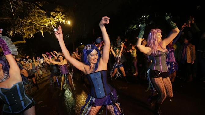 "Members of the Mardi Gras dance group ""The Sirens"" perform during the Krewe of Orpheus Mardi Gras parade in New Orleans, Monday, Feb. 11, 2013. (AP Photo/Gerald Herbert)"