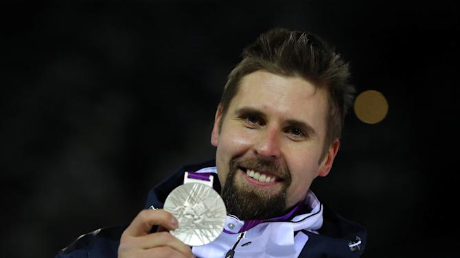 Finland's Ruuskanen poses with his silver medal for the London 2012 Olympic Games men's javelin throw final in Lahti