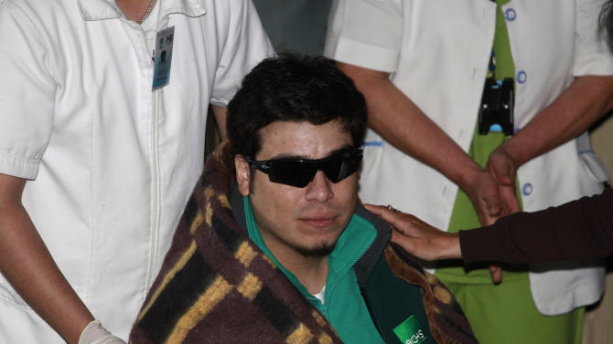 FILE - In this Oct. 13, 2010 file photo, the 31st of 33 miners to be rescued, Chilean miner Pedro Cortez arrives at the hospital after his rescue in Copiapo, Chile.  One of the myths surrounding the 33 miners who survived 69 days, 700 feet deep, and whose unprecedented and dramatic rescue was beamed to millions around the world, is that they are millionaires and do not need work. A year after the tragedy, nearly half are unemployed, one lives the fame that began to take shape at the bottom of the mine, many have chosen to give motivational talks to make a living and and four returned to work in the mines.  (AP Photo/Dario Lopez-Mills, File)