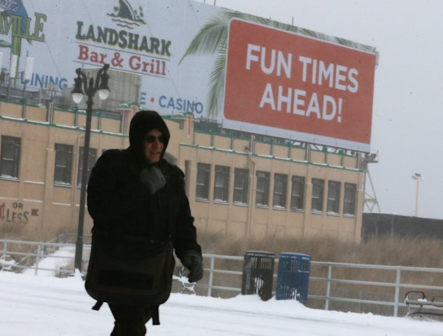 A man walks in the cold weather along the Atlantic City boardwalk on Jan. 27, 2015 (Mark Wilson/Getty Images)