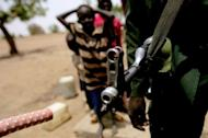A Sudanese soldier patrols following clashes between the army and South Sudan's forces in the town of Talodi in South Kordofan, about 50 kms (30 miles) from the disputed frontier with South Sudan. The leaders of both countries accused the other of wanting war