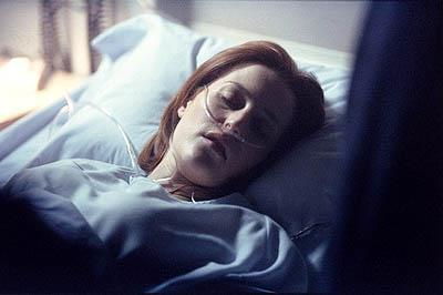 """A pregnant Dana Scully (Gillian Anderson) is rushed to the hospital with abdominal pains in the """"Empedocles"""" episode of Fox's The X-Files X-Files"""