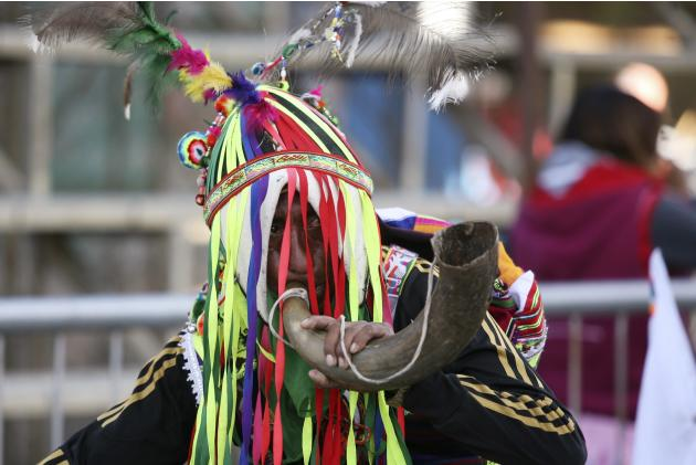 A Bolivian indigenous man participates in the Anata Andina (Andean carnival) in Oruro