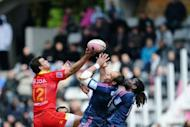 Perpignan's centre Rudolf Coetzee (L) fights for the ball with Stade Francais' number eight Sergio Parisse (C) and winger Paul Sackey at Charlety stadium in Paris. Stade Francais meanwhile did their hopes of breaking into the all-important top six a power of good by defeating Perpignan 35-31