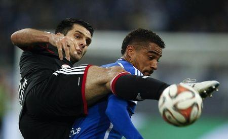 FC Schalke 04's Boateng challenges Bayer Leverkusen's Spahic during their Bundesliga first division soccer match in Gelsenkirchen