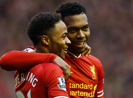 Liverpool's Sturridge celebrates his goal against Swansea with Sterling during their English Premier League soccer match in Liverpool