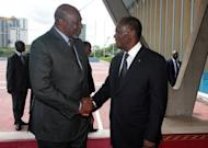 Mali's interim premier Cheick Modibo Diarra (left) is welcomed by Ivorian President Alassane Ouattara before a meeting at Abidjan's presidential palace. Ouattara is the head of the West African bloc ECOWAS. Mali's embattled transitional government has rejected a rebel alliance's declaration of an Islamic state in the vast desert north, a move that has plunged the nation closer to breakup