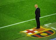 Barcelona's coach Josep Guardiola watches his team play Chelsea during the UEFA Champions League second leg semi-final football match Barcelona against Chelsea at the Cam Nou stadium in Barcelona on April 24. Guardiola is likely to announce on Friday whether he is staying or leaving the club, a source close to the team said Thursday