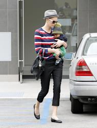 Well that's one way to grab our attention, Charlize! Spotted stepping out in Beverley Hills today, the Snow White and The Huntsman star sported a distinctly new look: a closely-shaved back and sides! Despite attempts to hide the shocking lack of locks under a grey fedora hat, Ms Theron's hair-do was were clearly visible