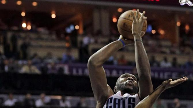 Charlotte Bobcats' Al Jefferson, back, shoots over Milwaukee Bucks' Brandon Knight, front, during the first half of an NBA basketball game, Monday, Dec. 23, 2013, in Charlotte, N.C