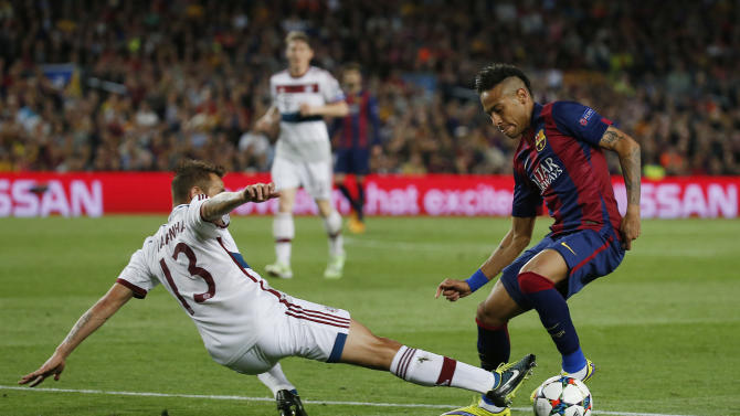 Football: Barcelona's Neymar in action with Bayern Munich's Rafinha