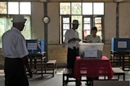 Voters cast their ballot papers during parliamentary by-elections at a polling station in Kawhmu on April 1. As a taboo on Myanmar political discussion wanes, pollsters are stepping up to take the pulse of the nation