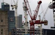 Construction work in the City of London financial district. Britain has slashed its economic outlook , forecasting the economy would shrink by 0.1 percent this year and then return to growth in 2013, according to figures published alongside a budget update.