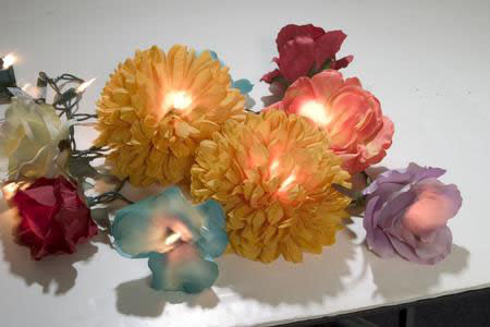 I love this idea from Crafty Chica. Create floral fantasy lights with fairy lights and silk flowers.
