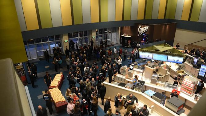 Guests fill the lobby of the Century Aurora cinema, formerly the Century 16, for a reopening and remembrance ceremony Thursday, Jan. 17, 2013 in Aurora, Colo. The theater is where 12 people were killed and dozens injured in a shooting rampage last July. (AP Photo/The Denver Post, RJ Sangosti, Pool)