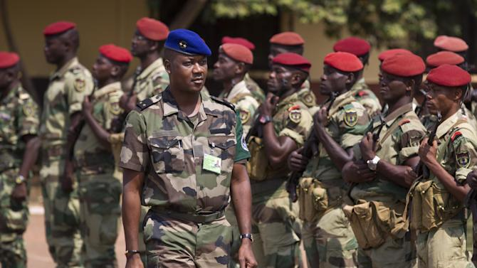 "Jean Felix Akaga, who heads a 10-nation regional force, inspects a contingent of forces from Gabon operating under the multinational central-African regional mandate, as they parade at their headquarters in the capital Bangui, Central African Republic, Wednesday, Jan. 2, 2013. Akaga says the town of Damara, about 70km (44 miles) north of the capital, is a ""red line that the rebels cannot cross"" or his forces will attack. (AP Photo/Ben Curtis)"