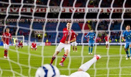 Norway's John Arne Riise scores a goal against Slovenia during their 2014 World Cup qualifying soccer match in Oslo