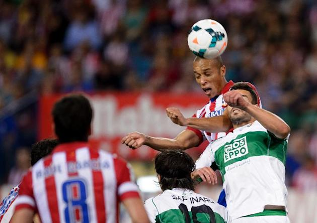 Atletico Madrid's defender Joa Miranda de Souza heads to score during a Spanish league football match against Elche at the Vicente Calderon stadium in Madrid on April 18, 2014