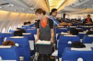 A transsexual fight attendant works onboard a Thai PC Air flight between Bangkok and Hong Kong. Months after taking to the skies with Thailand's first transsexual air crew, fledgling carrier PC Air has suspended services over financial troubles that left passengers stranded in South Korea