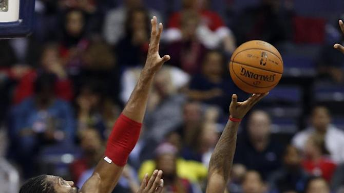 Cleveland Cavaliers guard Kyrie Irving (2) shoots over Washington Wizards forward Nene (42), from Brazil, in overtime of an NBA basketball game on Saturday, Nov. 16, 2013, in Washington. Irving had 41 points, and the Cavaliers won 103-96