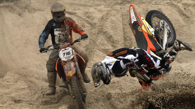 """Staufer of Austria falls on the sand during the """"Enduropale"""" motorcycle endurance race on the beach of Le Touquet"""