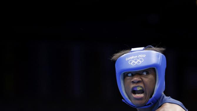 Kazakhstan's Marina Volnova fights Claressa Shields of the U.S. during their Women's Middle (75kg) semi-final boxing match at the London Olympic Games