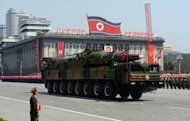 A military vehicle carries what is believed to be a Taepodong-class missile Intermediary Range Ballistic Missile (IRBM) during a military parade in Pyongyang on April 15, 2012. North Korea has warned of retaliation after the US scrapped food aid over its rocket launch, raising fears of a new nuclear test, as China reportedly suspended a refugee deal with its wayward ally