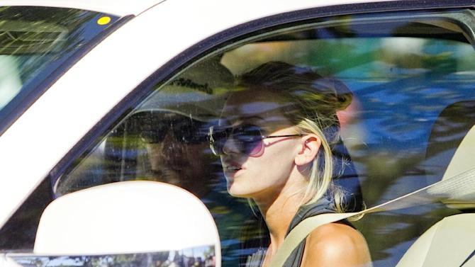 "FILE - In this Jan. 11, 2013, file photo, Paulina Gretzky, right, and Dustin Johnson drive away from the Waialae Country Club after Johnson withdrew from the Sony Open Golf Tournament after playing nine holes in the second round in Honolulu. PGA Tour player Johnson and Gretzky have taken to Twitter to say they are getting married. Johnson tweeted Sunday, Aug. 18, 2013, that ""she said yes!!!"" and included a picture of a large diamond ring on the daughter of hockey great Wayne Gretzky. (AP Photo/Marco Garcia, File)"